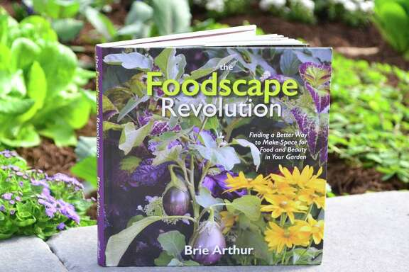 """Brie Arthur's book """"The Foodscape Revolution"""" offers suggestions for combining edibles and ornamentals in gardens."""