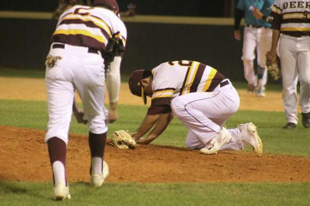 Deer Park relief pitcher Adrian Gonzales goes down to his knees after getting hit by a sizzling line drive off the bat of Kyle Hargrove during Memorial's winning rally in the seventh Tuesday night. Gonzales had to leave the game.