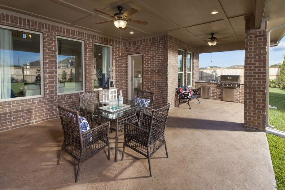 Coventry's Texas-sized patio with a built-in outdoor kitchen is an option in Veranda. Photo: McGuyer Homebuilders