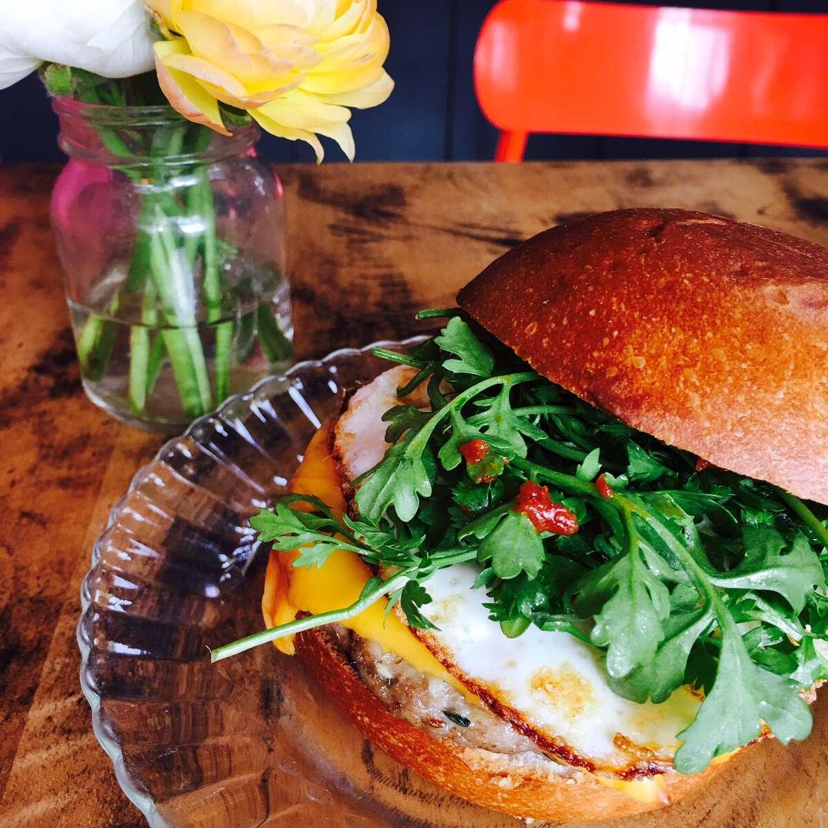 Mumbai Morning Burger: pork ginger sausage, fried egg, American cheese, peppercress, ghost pepper chutney