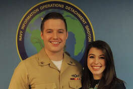 CTM2 Steven Soles and his wife Heidi, after he received his Enlisted Information Warfare specialist device.