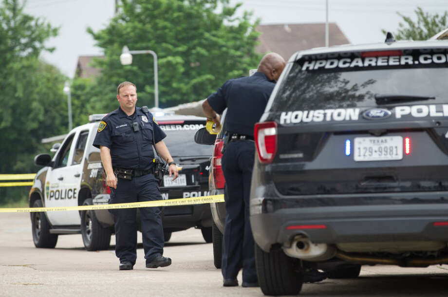 Houston Police officers investigate the scene where a person was shot on the 9300 block of Woodfair Drive Wednesday, April 26, 2017, in Houston. ( Godofredo A. Vasquez / Houston Chronicle )