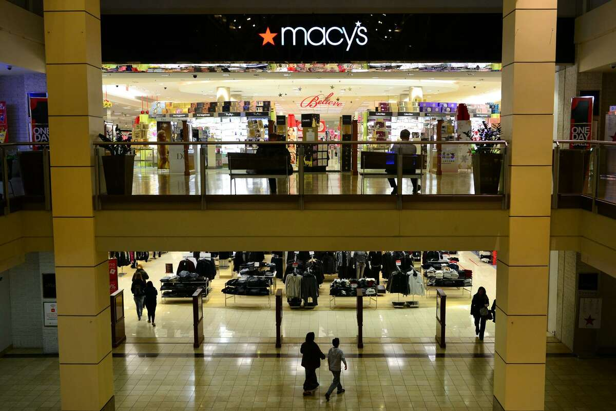 Shoppers go in and out of Macy's at Westfield's Connecticut Post Mall in Milford, Conn., on Wednesday Nov. 19, 2014.