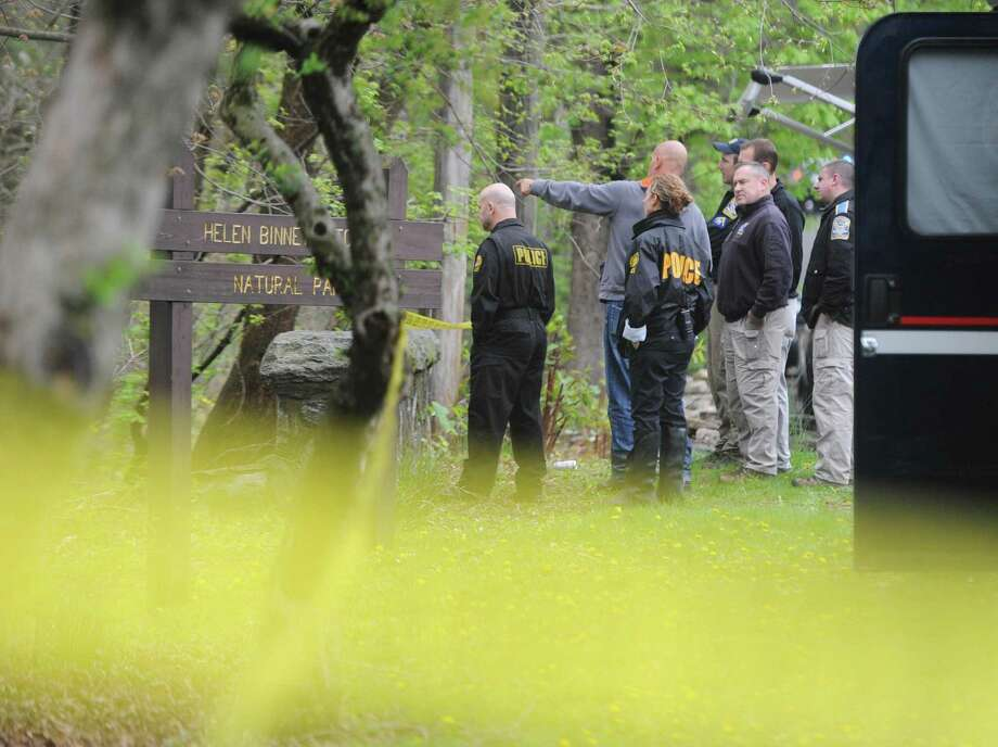 Greenwich police and state police investigate the scene in which possible human remains were found in Helen Binney Kitchel Natural Park in Old Greenwich, Conn. Wednesday, April 26, 2017. Town employees were clearing debris from the southwest section of woods when they discovered what appeared to them as being human remains. Photo: Tyler Sizemore / Hearst Connecticut Media / Greenwich Time