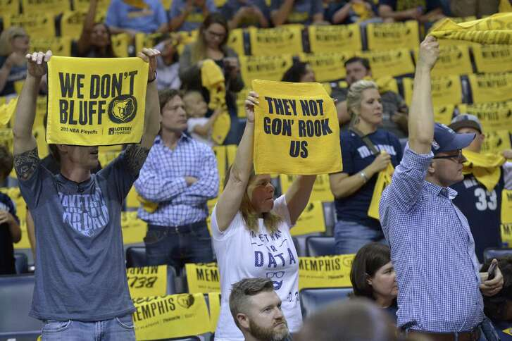 "Grizzlies fans wave ""Growl Towels"" during the first half of Game 3 during the first-round playoff series against the San Antonio Spurs on April 20, 2017, in Memphis, Tenn."