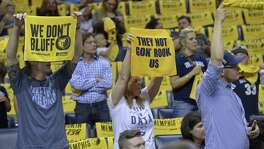 """Grizzlies fans wave """"Growl Towels"""" during the first half of Game 3 during the first-round playoff series against the San Antonio Spurs on April 20, 2017, in Memphis, Tenn."""