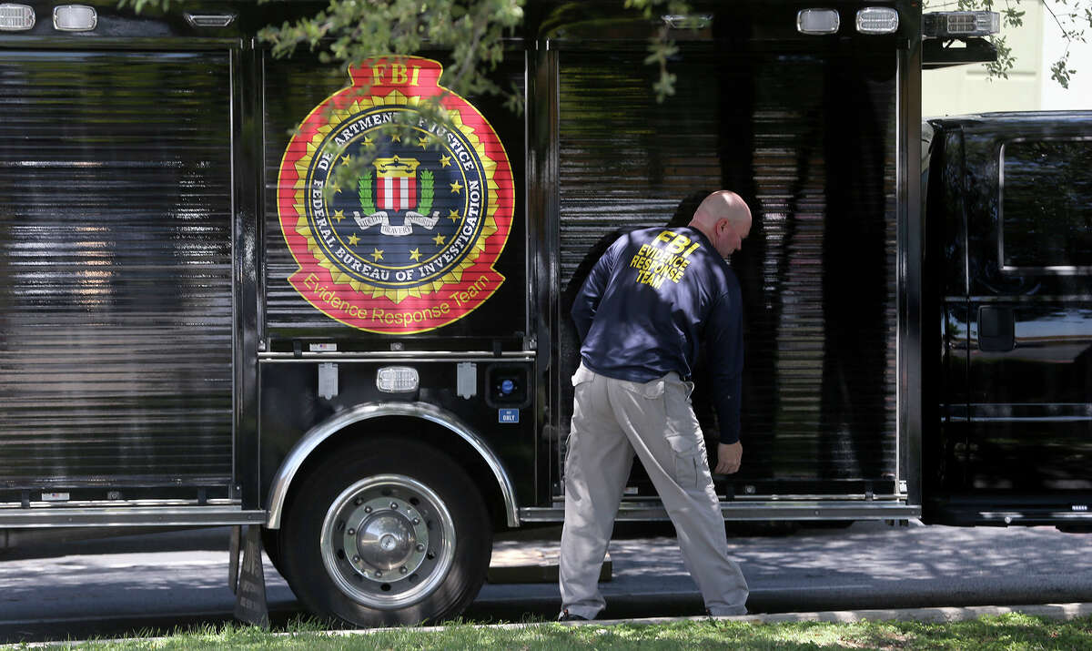 """A man wearing a shirt that reads """"FBI Evidence Response Team"""" prepares to open a truck Wednesday April 26, 2017 in front of the building located at 415 Embassy Oaks in San Antonio. A placard in front of the building was identified with the word """"Dannenbaum."""" According to the Laredo Morning Times website, the FBI has raided some city and county buildings in Laredo as well as Dannenbaum Engineering."""