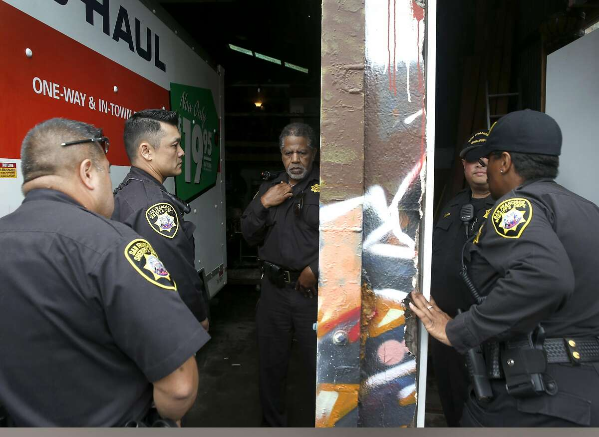 Sheriffs deputies enter the Bernal Haus artist collective after evicting residents living in the warehouse on Peralta Street in San Francisco, Calif. on Wednesday, April 26, 2017.