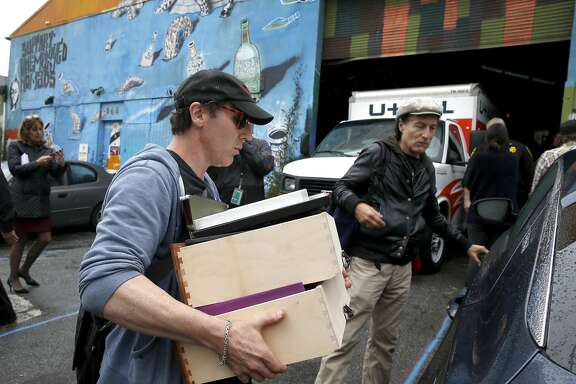 Nathan Cottam loads belongings into his car with the help of Tommi Avicolli Mecca (right), of the Housing Rights Committee of San Francisco, after sheriffs deputies evicted Cottam and other residents of the Bernal Haus artist collective at a warehouse on Peralta Street in San Francisco, Calif. on Wednesday, April 26, 2017.