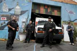 Nathan Cottam (right) stands outside of the Bernal Haus artist collective after sheriffs deputies evicted him and other residents living in a warehouse on Peralta Street in San Francisco, Calif. on Wednesday, April 26, 2017.
