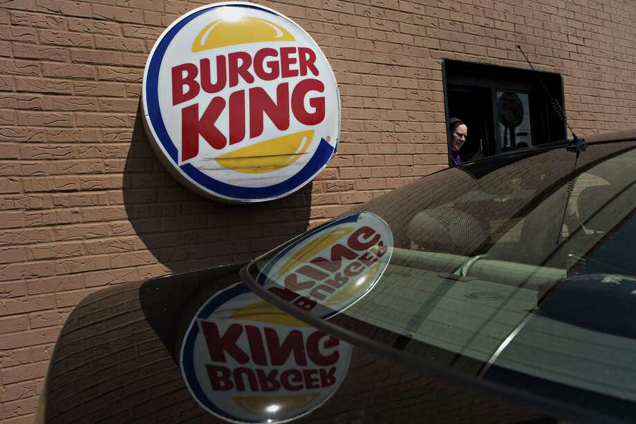 Burger King's same-store sales fell 0.1 percent in the first three months of the year. That trailed the 1.5 percent gain estimated by analysts, according to Consensus Metrix. In the U.S., its same-store sales fell 2.2 percent, according to a statement. Analysts estimated a 0.3 percent drop for the U.S. and Canada combined. Photo: Bloomberg News File Photo / © 2014 Bloomberg Finance LP