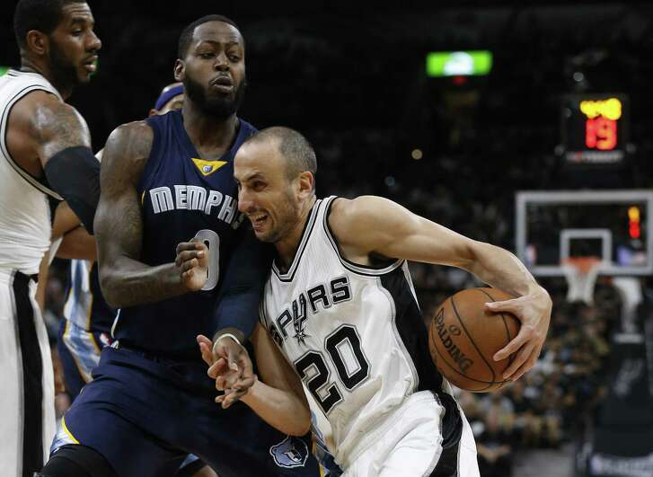 Spurs' Manu Ginobili drives to the paint for a score and one against Memphis Grizzlies' JaMychal Green during Game 5 of the Western Conference playoffs at the AT&T Center on April 25, 2017.