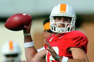 Tennessee's Quinten Dormady (12) looks to pass during NCAA college spring football training in Knoxville, Tenn., on Thursday, March 30, 2017. (Calvin Mattheis/Knoxville News Sentinel via AP)