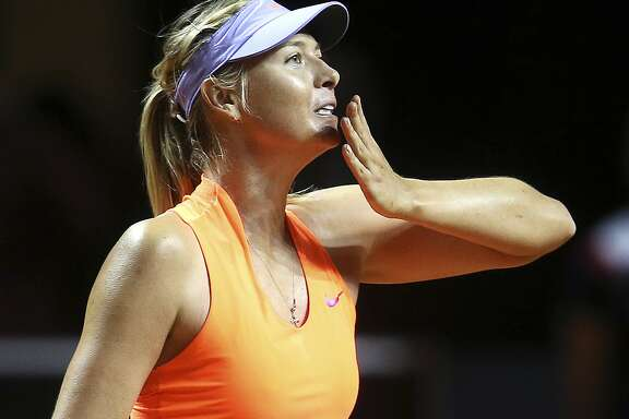 Russia's Maria Sharapova blows a kiss after winning 7-5, 6-3 against Italy's Roberta Vinci at the Porsche Tennis Grand Prix in Stuttgart, Germany, Wednesday, April 26, 2017. It was Sharapova's first match after a 15 months lasting doping ban. (AP Photo/Michael Probst)