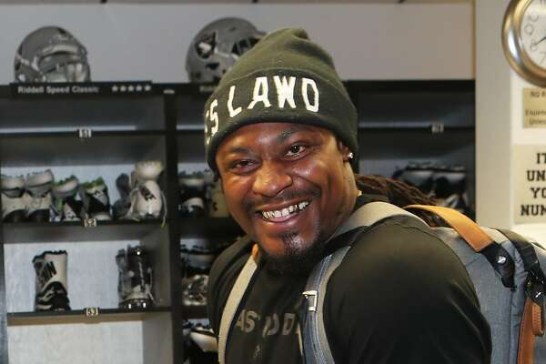 Oakland native and Cal alum Marshawn Lynch was all smiles Wednesday after agreeing to a two-year deal with the Raiders.