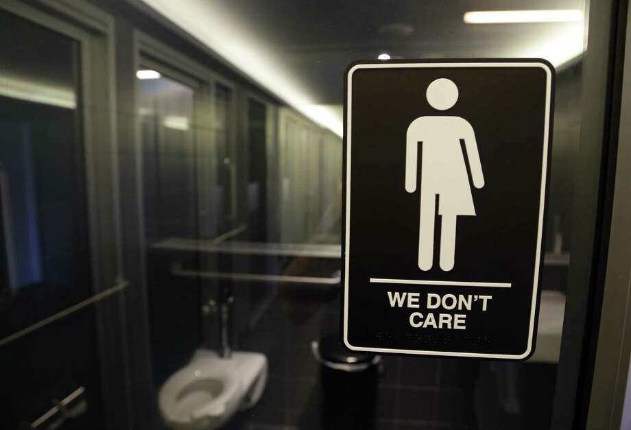 A sign outside a restroom in Durham, N.C., reflects the attitude of readers weighing in on the Texas version of bathroom legislation. Photo: Gerry Broome /Associated Press / Stratford Booster Club