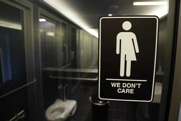 A sign outside a restroom in Durham, N.C., reflects the attitude of readers weighing in on the Texas version of bathroom legislation.