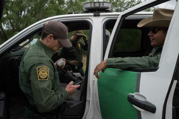 U.S. Border Patrol agents Kelby Forbes, left, Garrett Gremes and David Garcia at a staging area in La Grulla, Texas, April 7. President Trump's tough talk on cracking down on undocumented immigration has had an effect — fewer attempted border crossings.