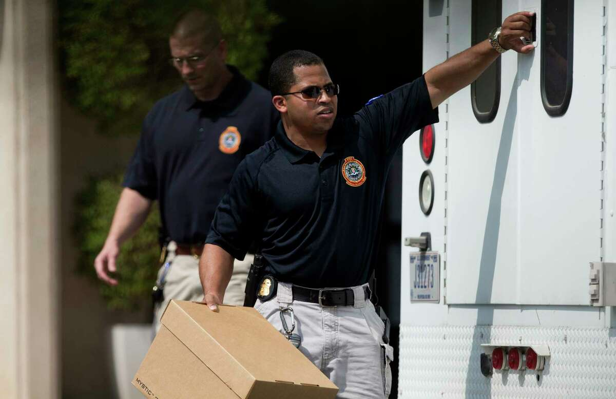 FBI officers collect evidence from the Dannenbaum Engineering firm at 3100 Alabama Street Wednesday, April 26, 2017, in Houston.