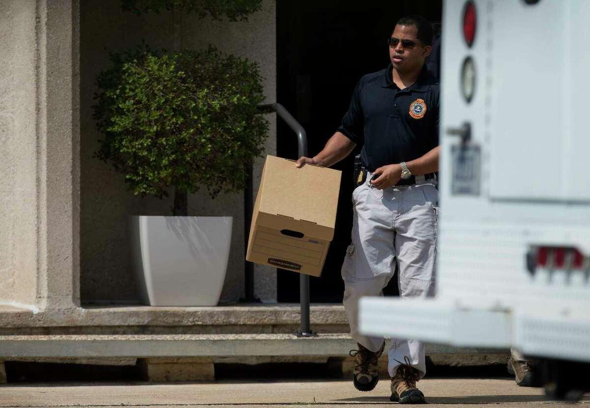 FBI officers collect evidence from the Dannenbaum Engineering firm at 3100 Alabama Street Wednesday, April 26, 2017, in Houston. The FBI also raided the company's locations in San Antonio, McAllen, and Laredo.