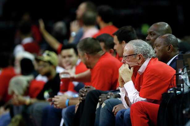 Houston Rockets owner Les Alexander sits on the sidelines in the second half of Game 5 of a Western Conference quarterfinals of the 2017 NBA playoffs, April 24, 2017, in Houston.