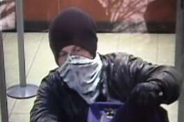 A security camera photo of the thief who robbed the Chase bank at 1150 E Putnam Ave. Wednesday.