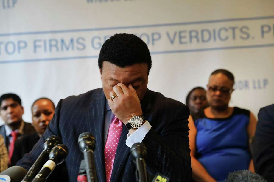 Fox News anchor Kelly Wright becomes emotional as he joins other current and former Fox employees at a news conference Wednesday organized by his attorney Doug Wigdor of Wigdor LLP. Wright, and ten other plaintiffs, filed an amended lawsuit in New York state court in which they claim that they faced years of racial discrimination at Fox. Photo: Spencer Platt /Getty Images / 2017 Getty Images