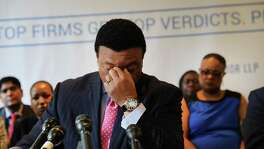 Fox News anchor Kelly Wright becomes emotional as he joins other current and former Fox employees at a news conference Wednesday organized by his attorney Doug Wigdor of Wigdor LLP. Wright, and ten other plaintiffs, filed an amended lawsuit in New York state court in which they claim that they faced years of racial discrimination at Fox.