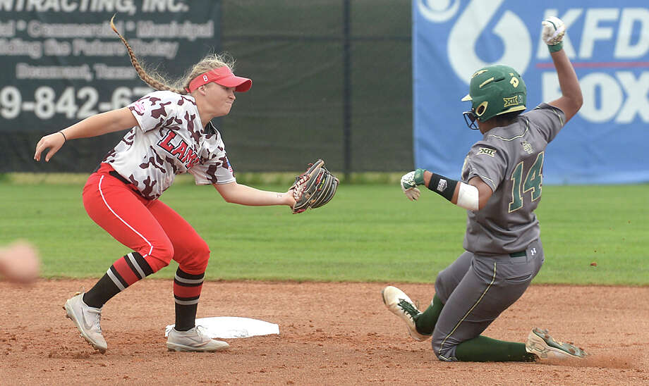 Lamar's Shelby Hughston looks for the out on Baylor's Ari Hawkins during their game at home Tuesday. Photo taken Tuesday, April 25, 2017 Kim Brent/The Enterprise Photo: Kim Brent / BEN