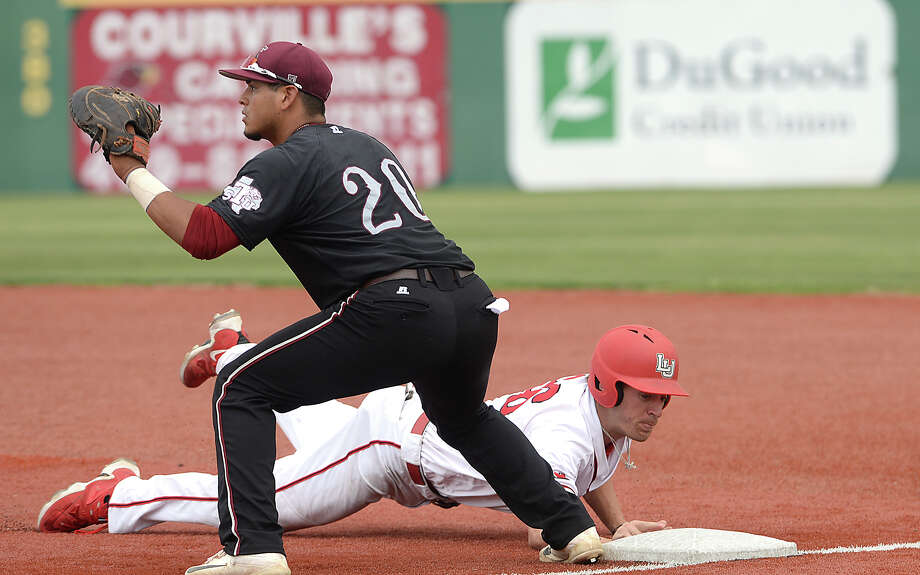 Lamar's Cutter McDowell dives back to first ahead of the throw to Texas Southern's Christian Sanchez during their game at home Tuesday. Photo taken Tuesday, April 25, 2017 Kim Brent/The Enterprise Photo: Kim Brent / BEN