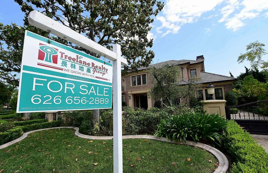 (FILES) This file photo taken on May 17, 2016 shows a house for sale in Arcadia, California. US sales of existing homes rose again in January to hit their fastest pace in nearly a decade despite rising prices and mortgage rates, according to data released on February 22, 2017.The pop in sales suggested recent consumer confidence and robust job gains again bolstered homebuyers' willingness to sign on the dotted line. Sales of condos, single-family homes, townhouses and other pre-owned homes gained 3.3 percent for the month, hitting a seasonally adjusted rate of 5.69 million units, the National Association of Realtors said in its monthly report. / AFP PHOTO / FREDERIC J. BROWNFREDERIC J. BROWN/AFP/Getty Images Photo: FREDERIC J. BROWN, AFP/Getty Images