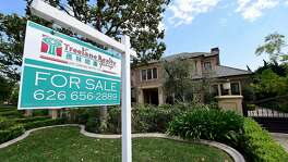 (FILES) This file photo taken on May 17, 2016 shows a house for sale in Arcadia, California. US sales of existing homes rose again in January to hit their fastest pace in nearly a decade despite rising prices and mortgage rates, according to data released on February 22, 2017.The pop in sales suggested recent consumer confidence and robust job gains again bolstered homebuyers' willingness to sign on the dotted line. Sales of condos, single-family homes, townhouses and other pre-owned homes gained 3.3 percent for the month, hitting a seasonally adjusted rate of 5.69 million units, the National Association of Realtors said in its monthly report.  / AFP PHOTO / FREDERIC J. BROWNFREDERIC J. BROWN/AFP/Getty Images