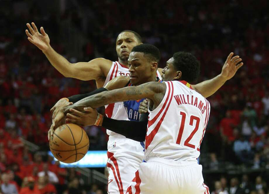 Oklahoma City Thunder guard Russell Westbrook (0) fights against Houston Rockets guards Lou Williams (12) and Eric Gordon (10) in the second half of Game 5 of a Western Conference quarterfinals of the 2017 NBA playoffs, April 24, 2017, in Houston. ( Karen Warren / Houston Chronicle ) Photo: Karen Warren, Staff Photographer / 2017 Houston Chronicle