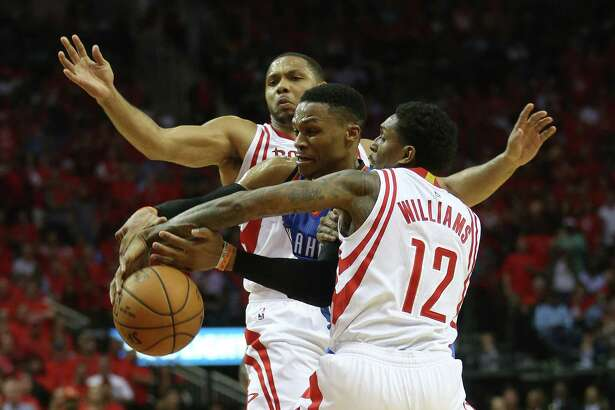 Oklahoma City Thunder guard Russell Westbrook (0) fights against Houston Rockets guards Lou Williams (12) and Eric Gordon (10) in the second half of Game 5 of a Western Conference quarterfinals of the 2017 NBA playoffs, April 24, 2017, in Houston. ( Karen Warren / Houston Chronicle )