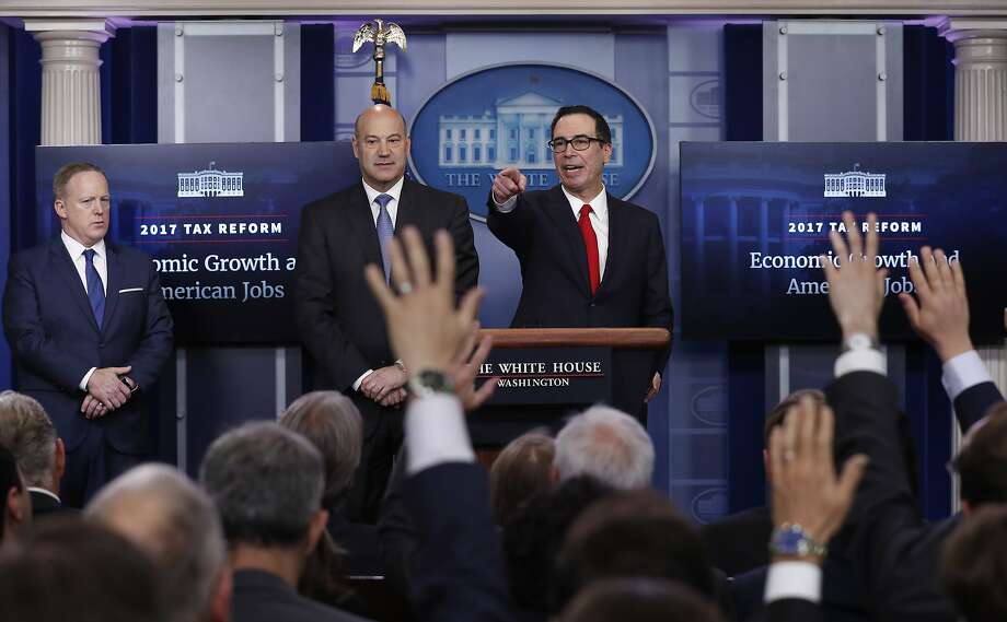Treasury Secretary Steven Mnuchin, right, joined by National Economic Director Gary Cohn, center, and White House press secretary Sean Spicer speaks in the briefing room of the White House in Washington, Wednesday, April 26, 2017. President Donald Trump is proposing dramatically reducing the taxes paid by corporations big and small in an overhaul his administration says will spur economic growth and bring jobs and prosperity to the middle class. (AP Photo/Carolyn Kaster) Photo: Carolyn Kaster, Associated Press