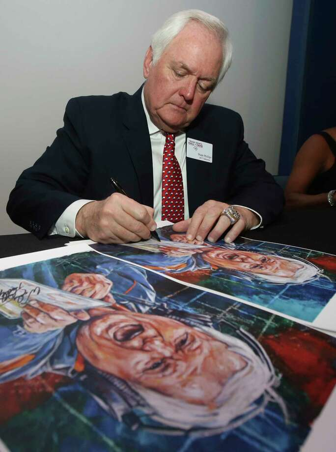 Wade Phillips autographs a poster of his coaching days in the NFL with the Denver Broncos Tuesday Feb. 21, 2017, in Waco, Texas before being inducted into the Texas Sports Hall of Fame class of 2017. (Jerry Larson/Waco Tribune Herald via AP) Photo: Jerry Larson, MBO / Waco Tribune Herald