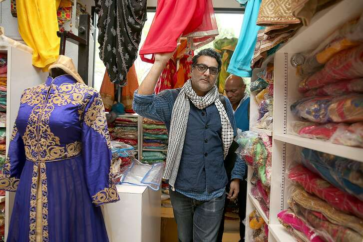 Costume designer Arjun Bhasin walks through Sari Palace near the Berkeley Rep on Tuesday, April 25, 2017, in Berkeley, Calif.