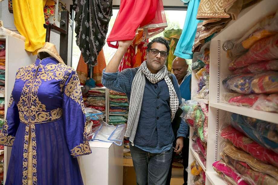 Costume designer Arjun Bhasin walks through Sari Palace on University Avenue in Berkeley. Photo: Liz Hafalia, The Chronicle