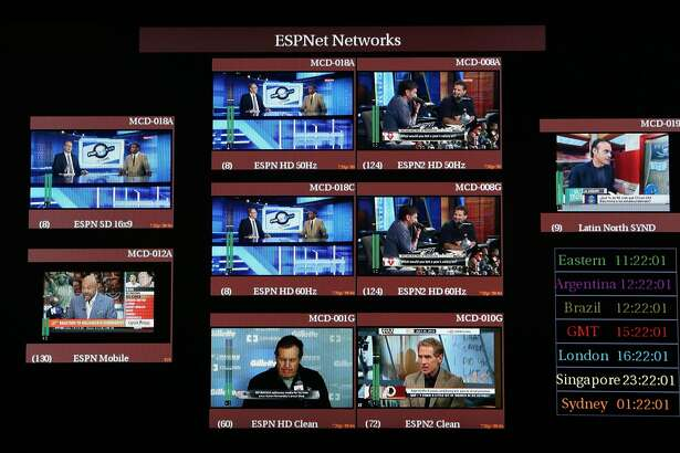 FILE -- A control room at ESPN headquarters in Bristol, Conn., July 25, 2013. ESPN on April 26, 2017, began another round of layoffs, this one aimed at on-air personalities, perhaps the starkest sign yet of the financial reckoning playing out in sports broadcasting as cord-cutting proliferates. (Richard Perry/The New York Times)