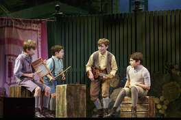 "Mitchell Wray (from left), Jordan Cole, Finn Faulconer and Ben Krieger play brothers in the touring production of ""Finding Neverland"" that is coming to the Majestic Theatre."