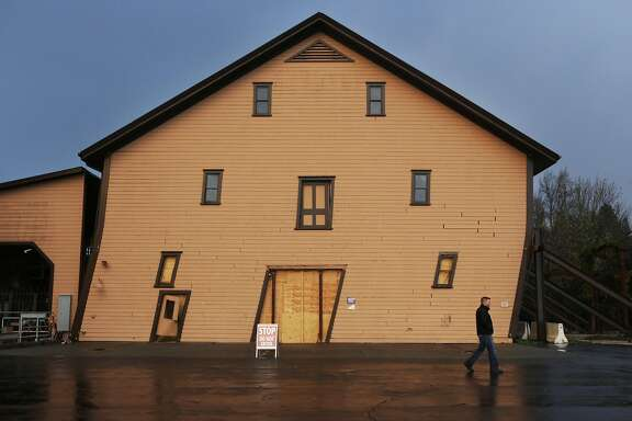 A Trefethen Family Vineyards employee walks past Trefethen's historic winery building on Thursday, November 20, 2014. The building was was thrown askew in the magnitude-6.0 earthquake that shook northern California on August 23.