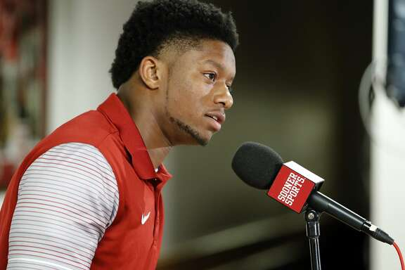 FILE - In this Dec. 23, 2016, file photo, Oklahoma football player Joe Mixon speaks out for the first time since the release of a 2014 video showing him punching a woman in the face, at a press conference in Norman, Okla. Oklahoma receiver Dede Westbrook believes Joe Mixon should be at this week's NFL's scouting combine. Mixon was absent during Friday's, March 3, 2017, running back workouts because a league policy bars players convicted of violent crimes from attending. Mixon and Westbrook were college teammates.  (Steve Sisney/The Oklahoman via AP, File)
