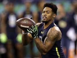 FILE - In this March 6, 2017, file photo, Ohio State defensive back Gareon Conley runs a drill at the NFL football scouting combine in Indianapolis. An attorney for the former Ohio State star says the player denies an accusation made in a police report released Tuesday, April 25, 2017, that he sexually assaulted a woman. No charges have been filed and the incident is still being investigated by police. (AP Photo/David J. Phillip, File)