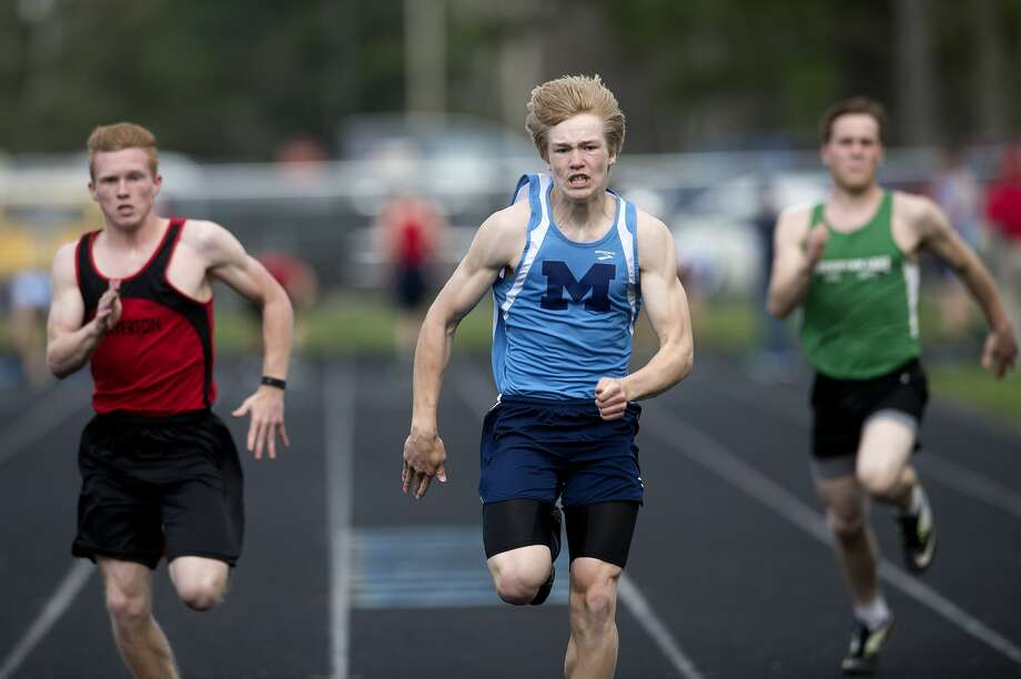 Beaverton's David Jenkins, Meridian's Kyle Stockford and Houghton Lake's Austin Land race in the 100 meter dash during a track meet Wednesday afternoon. Stockford won the race. Photo: Brittney Lohmiller/Midland Daily News/Brittney Lohmiller