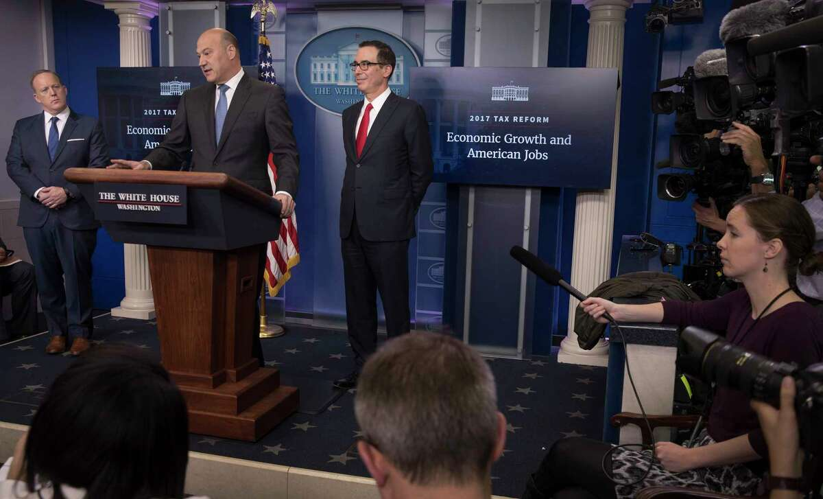 The Trump administration on Wednesday proposed sharp reductions in both individual and corporate income tax rates. From left are Press Secretary Sean Spicer, Gary Cohn, the former Goldman Sachs executive and chief economic adviser to President Donald Trump, and Treasury Secretary Steven Mnuchin. (Photo by Stephen Crowley/The New York Times)