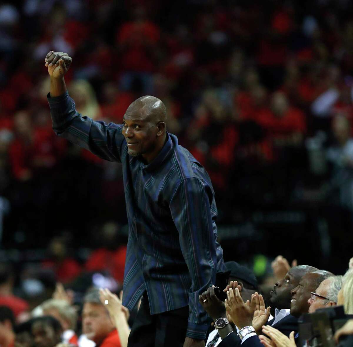 Hakeem Olajuwon waves to the crowd in the second half of Game 5 of a Western Conference quarterfinals of the 2017 NBA playoffs, April 24, 2017, in Houston. ( Karen Warren / Houston Chronicle ) Houston Rockets guard James Harden (13) tries to get Patrick Beverley off the court after the Rockets beat Oklahoma City Thunder in Game 5 of a Western Conference quarterfinals of the 2017 NBA playoffs, April 24, 2017, in Houston. ( Karen Warren / Houston Chronicle )