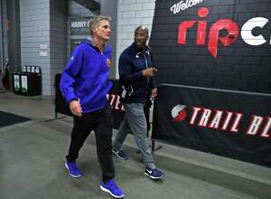 Golden State Warriors' head coach Steve Kerr and interim head coach Mike Brown head to team bus after shoot around before Game 4 of NBA Western Conference 1st Round Playoffs at Moda Center in Portland, Oregon on Monday, April 24, 2017.