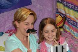 Michele MacDonnell and her daughter, Brynn, 8, capture a lighthearted moment together at the selfie station, one of several stations set up at the Girls' Night Out event, co-hosted by New Milford Girl Scout Troops 40326 and 40325 April 21, 2017, at New Milford High School. The mother-daughter event was based on a pajama party theme.