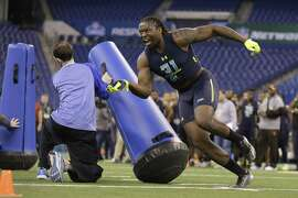 UCLA defensive end Takkarist Mckinley runs a drill at the NFL football scouting combine in Indianapolis, Sunday, March 5, 2017. (AP Photo/Michael Conroy)