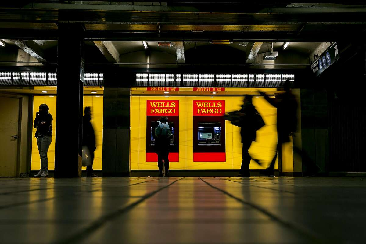 Wells Fargo ATM machines in the Port Authority subway station in New York, April 7, 2017. Wells Fargo�s board said April 10, that it would claw back an additional $75 million in compensation from the two executives on whom it pinned most of the blame for the company�s sales scandal: the bank�s former chief executive, John Stumpf, and its former head of community banking, Carrie Tolstedt. (Sam Hodgson/The New York Times)
